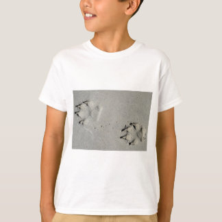 Tracks of a big dog on the sand T-Shirt