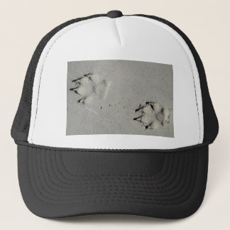Tracks of a big dog on the sand trucker hat