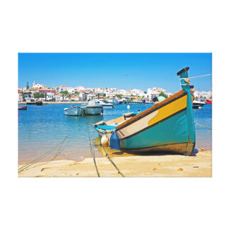 Traditional boat in the harbor from Lagos Portugal Canvas Print