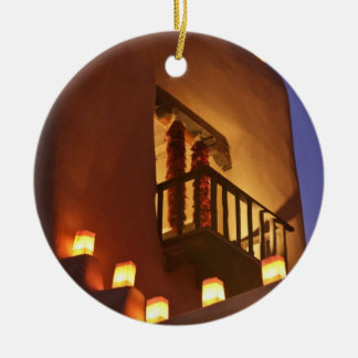 Traditional farolitos light up adobe structures 2 ceramic ornament