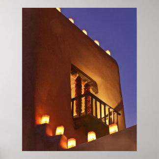 Traditional farolitos light up adobe structures 2 poster