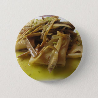 Traditional italian Paccheri pasta with artichokes 2 Inch Round Button