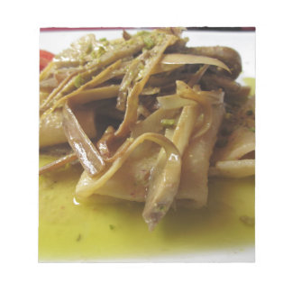 Traditional italian Paccheri pasta with artichokes Notepad