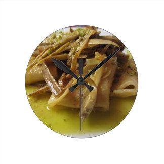 Traditional italian Paccheri pasta with artichokes Round Clock
