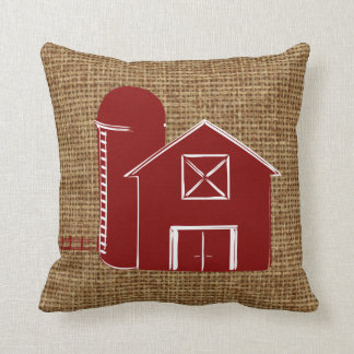 Traditional red barn with silo on faux burlap throw pillow