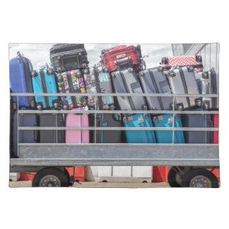 Trailer on airport filled with suitcases.JPG Placemat
