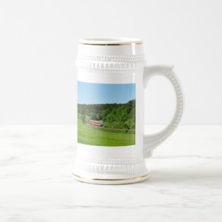 Tramcar with meadow field beer stein