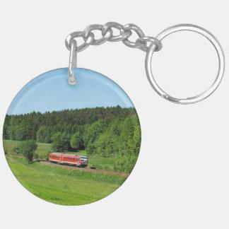 Tramcar with meadow field keychain