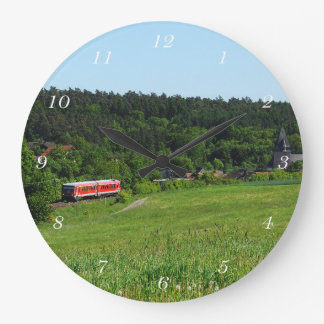 Tramcar with meadow field large clock