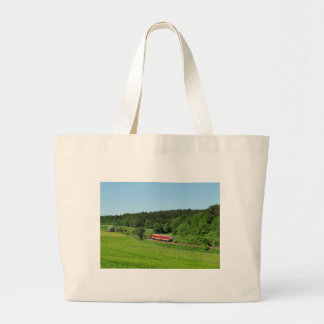 Tramcar with meadow field large tote bag