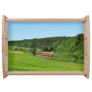 Tramcar with meadow field serving tray