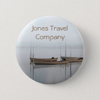 Tranquil boats in a still bay travel company 2 inch round button