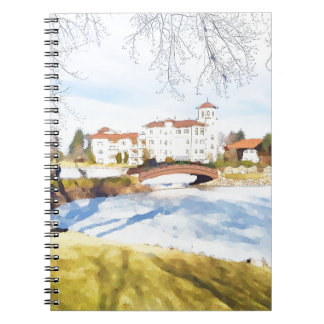 Tranquil hotel scene on lake notebook