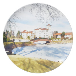 Tranquil hotel scene on lake party plates