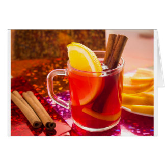 Transparent cup of tea with citrus and cinnamon card