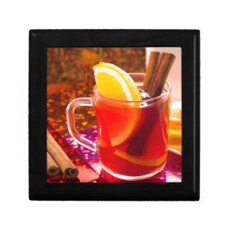 Transparent cup of tea with citrus and cinnamon gift box