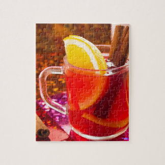 Transparent cup of tea with citrus and cinnamon jigsaw puzzle