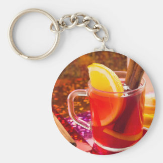 Transparent cup of tea with citrus and cinnamon keychain