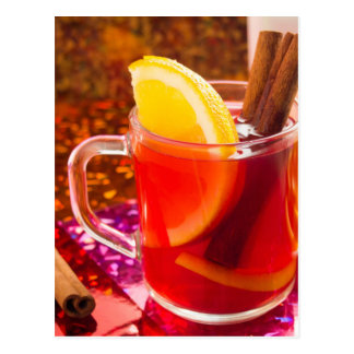 Transparent cup of tea with citrus and cinnamon postcard