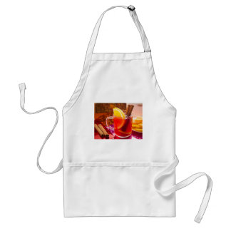 Transparent cup of tea with citrus and cinnamon standard apron