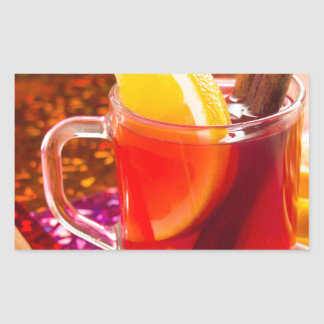 Transparent cup of tea with citrus and cinnamon sticker