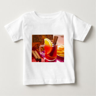 Transparent cup of tea with citrus, cinnamon baby T-Shirt