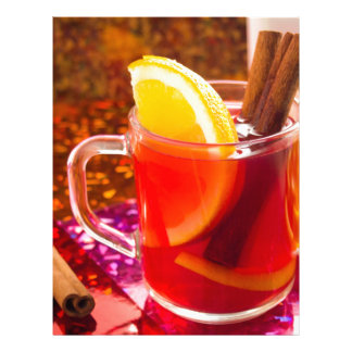 Transparent cup of tea with citrus, cinnamon letterhead