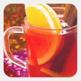 Transparent cup of tea with citrus, cinnamon square sticker