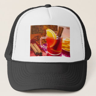 Transparent cup of tea with citrus, cinnamon trucker hat