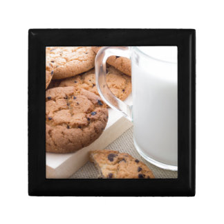 Transparent cup with milk and oatmeal cookies gift box