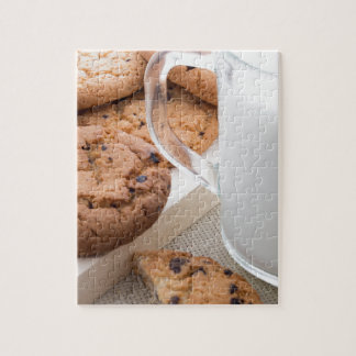 Transparent cup with milk and oatmeal cookies jigsaw puzzle