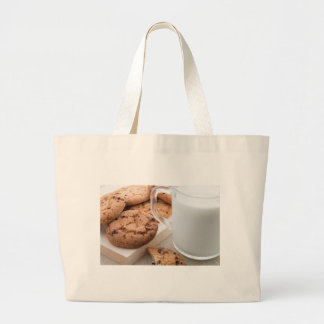 Transparent cup with milk and oatmeal cookies large tote bag