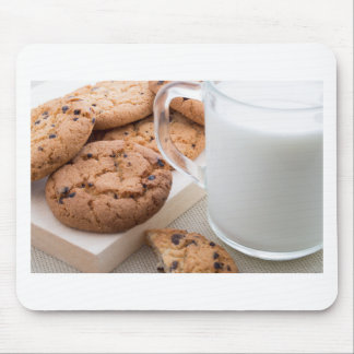Transparent cup with milk and oatmeal cookies mouse pad