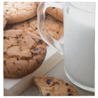 Transparent cup with milk and oatmeal cookies napkin