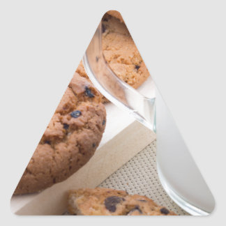 Transparent cup with milk and oatmeal cookies triangle sticker