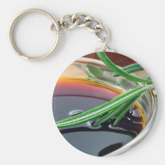 Transparent cup with soy sauce and rosemary leaves keychain