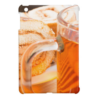 Transparent glass mug with hot tea and chocolate iPad mini covers