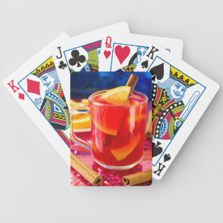Transparent mug with citrus mulled wine bicycle playing cards