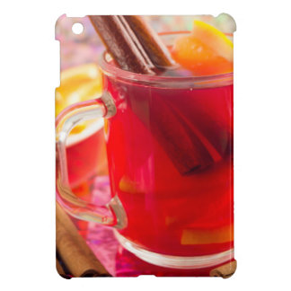 Transparent mug with citrus mulled wine, cinnamon cover for the iPad mini