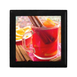 Transparent mug with citrus mulled wine, cinnamon gift box