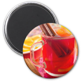 Transparent mug with citrus mulled wine, cinnamon magnet
