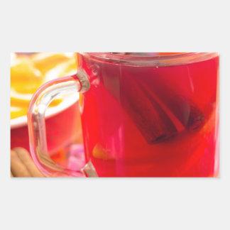 Transparent mug with citrus mulled wine, cinnamon sticker