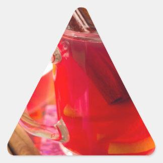 Transparent mug with citrus mulled wine, cinnamon triangle sticker