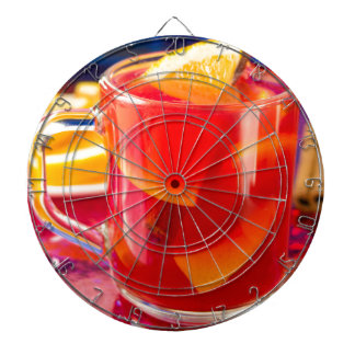 Transparent mug with citrus mulled wine dart boards