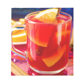 Transparent mug with citrus mulled wine notepad