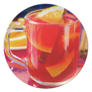 Transparent mug with citrus mulled wine plate