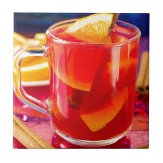 Transparent mug with citrus mulled wine tile