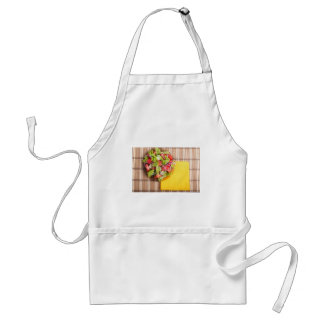 Transparent plate with fresh summer salad on a mat standard apron