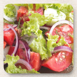Transparent plate with vegetable salad closeup drink coaster