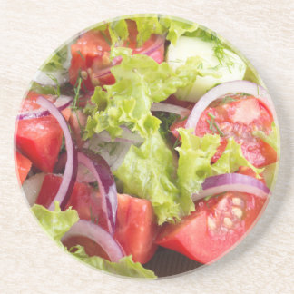 Transparent plate with vegetable salad closeup drink coasters